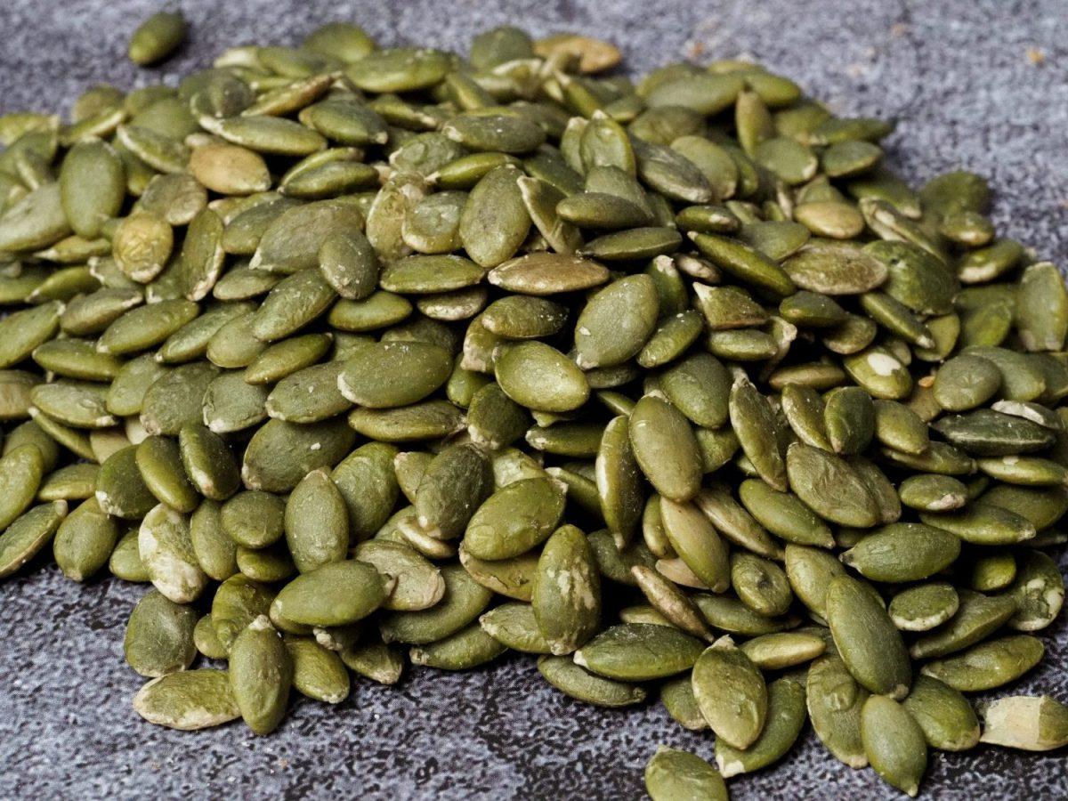 A pile of raw pepitas (pumpkin seeds)