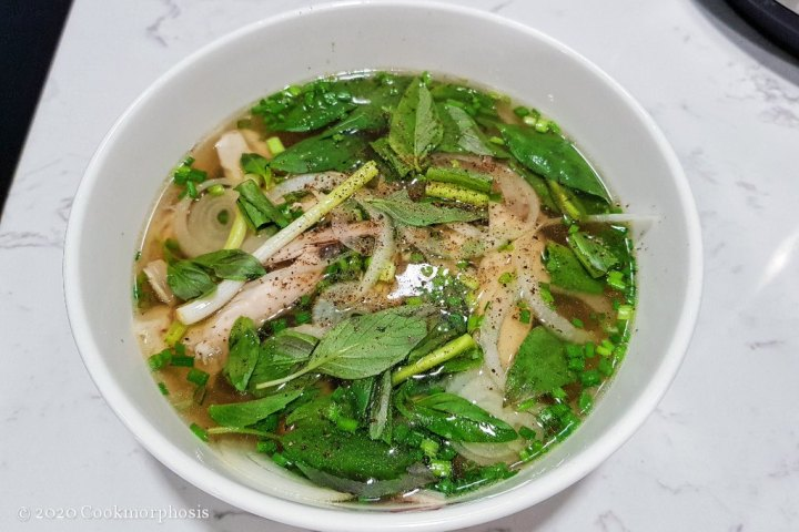 pho soup with white scallion, chopped green onion, and picked cualantro