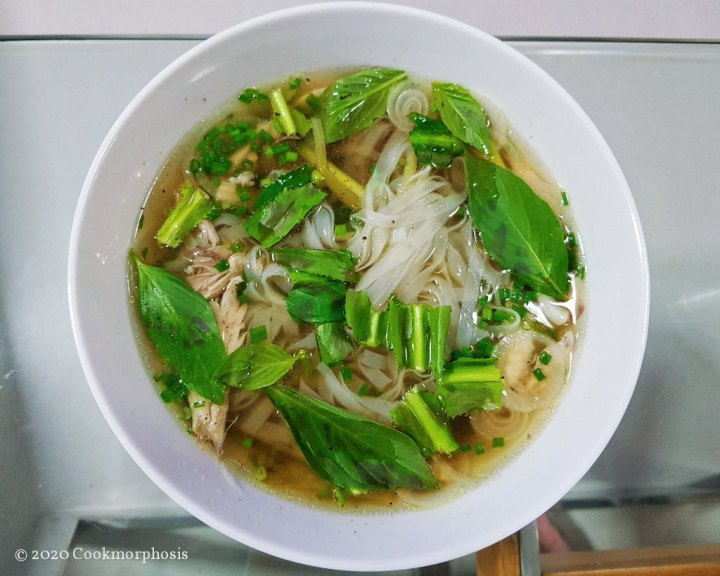 authentic vietnamese chicken pho with basil and cualantro as garnish