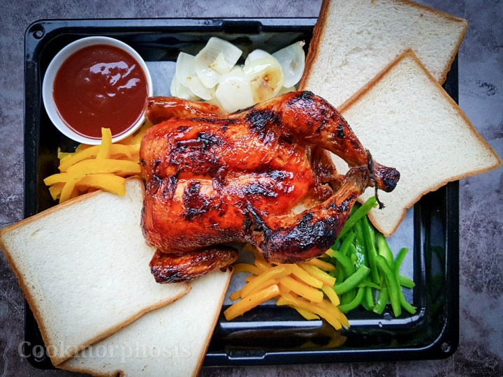 perfect roasted whole chicken served with bbq sauce, white sandwich, saute bell pepper