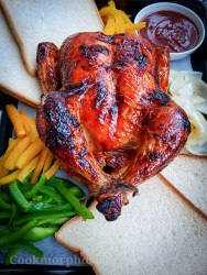 perfect roasted whole chicken glazed with sweet and spicy bbq sauce