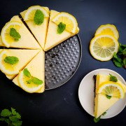 no-bake lemon chiffon cake recipe garnished with fresh lemon and mint leaves