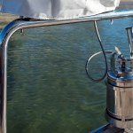 Stainless gas bottle holder on stern rail by Cookout BBQ's