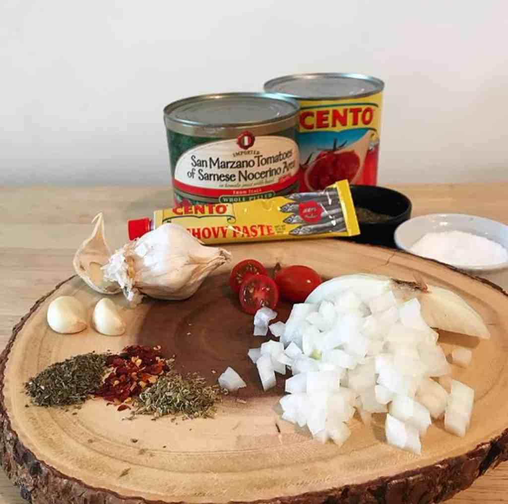 marinara ingredients on a wooden block.