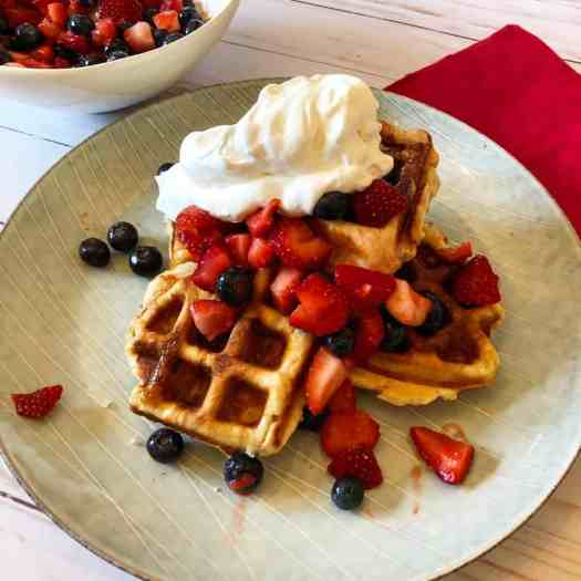 Belgian liege waffles with berries and whipped cream