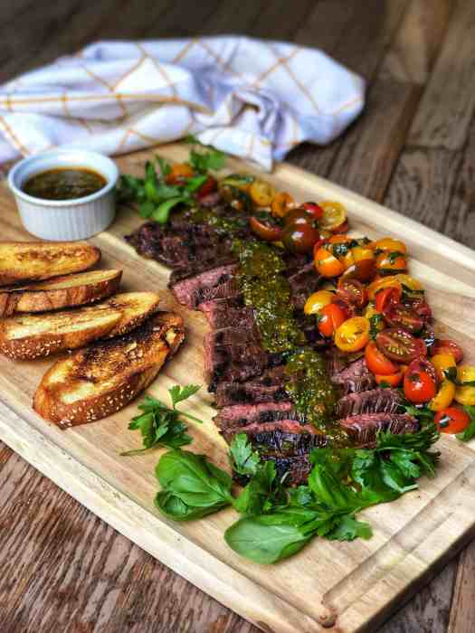 Skirt steak with Italian chimichurri and tomatoes