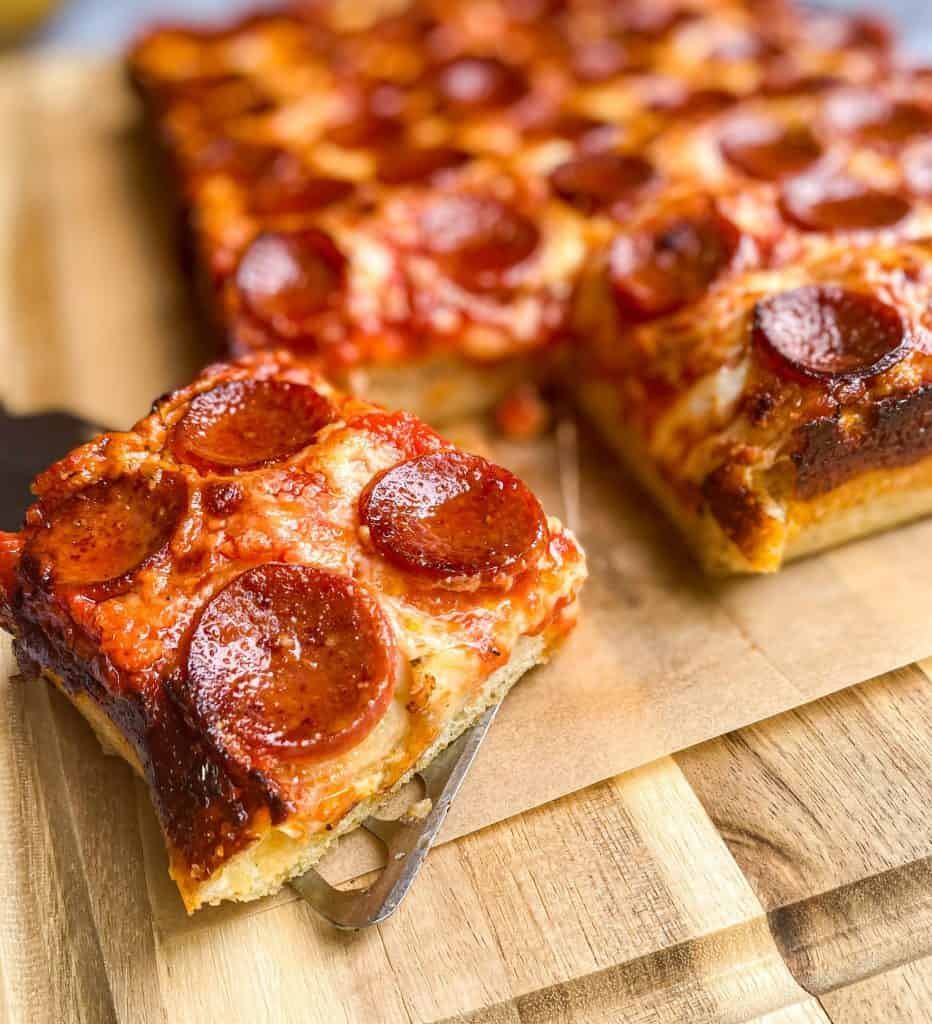 Square slice of Pizza al Taglio (thick crust pizza)