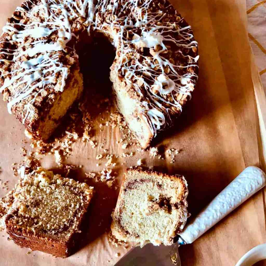 Two slices of Sour Cream Banana Coffee Cake on a cutting board.