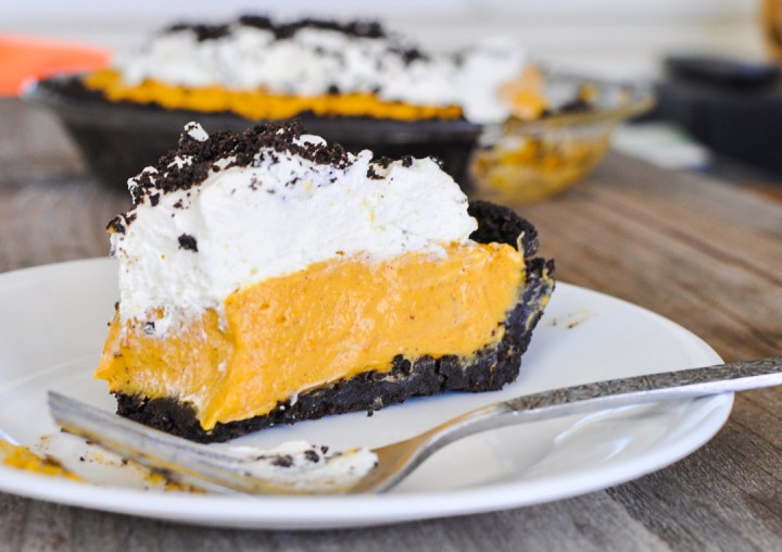 a slice of pumpkin no-bake cheesecake on a white plate