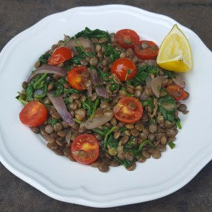 Warm lentil, tomato and spinach salad