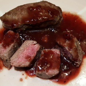 Pan-fried venison with cranberry sauce