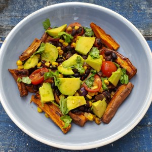 Sweet potato chips with spiced beans, corn and avocado