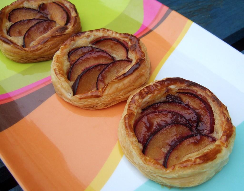 Puff-pastry plum and frangipane tarts