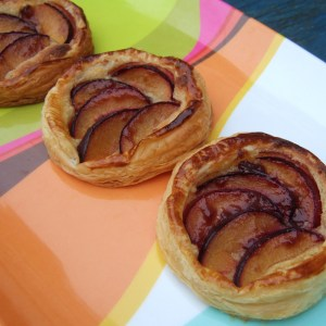 Puff-pastry plum and frangipane tarts