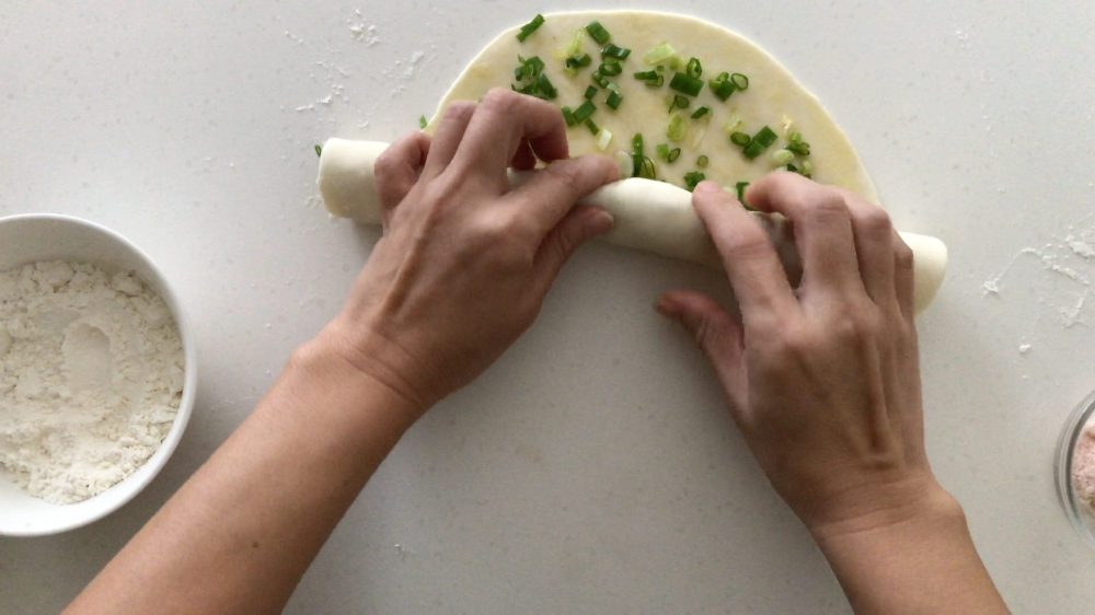 Rolling up the pancake with both hands