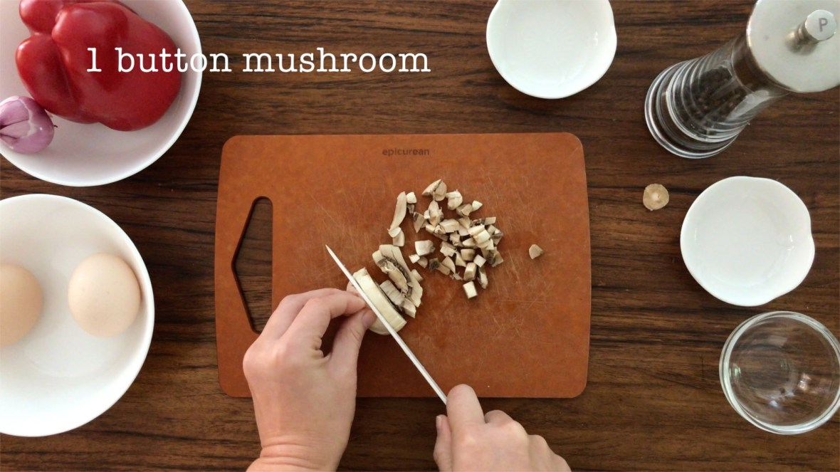 cutting a button mushroom into small cubes