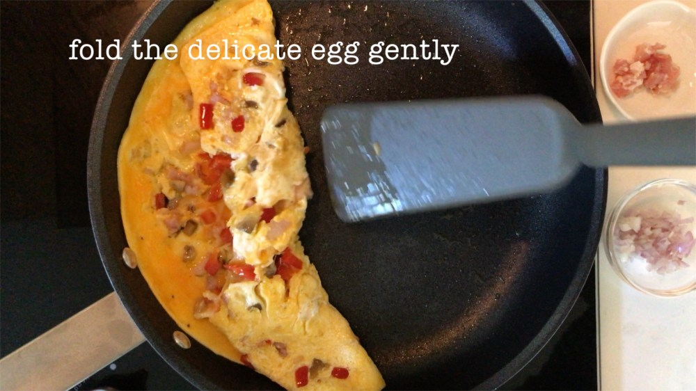 folding the omelette gently