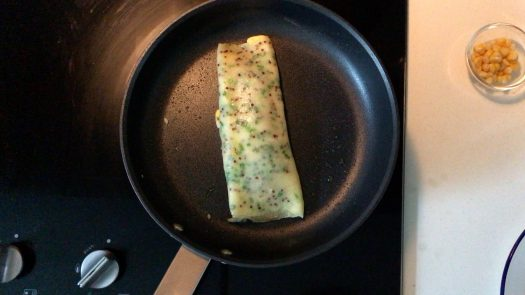 Browning a Taiwanese egg pancake roll in a pan