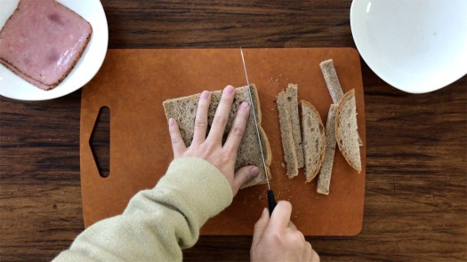 Cut off the crust of two slices of brown bread