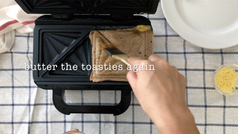 Brush the toasties with melted butter again