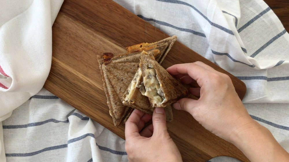 Serving crunchy mushroom toasties on a wooden board
