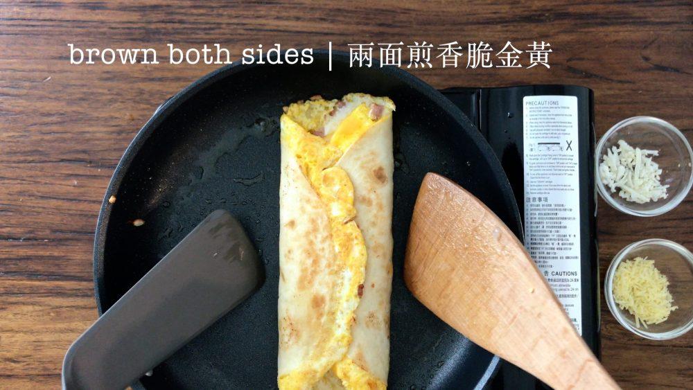 Brown a egg tortilla wrap in a pan