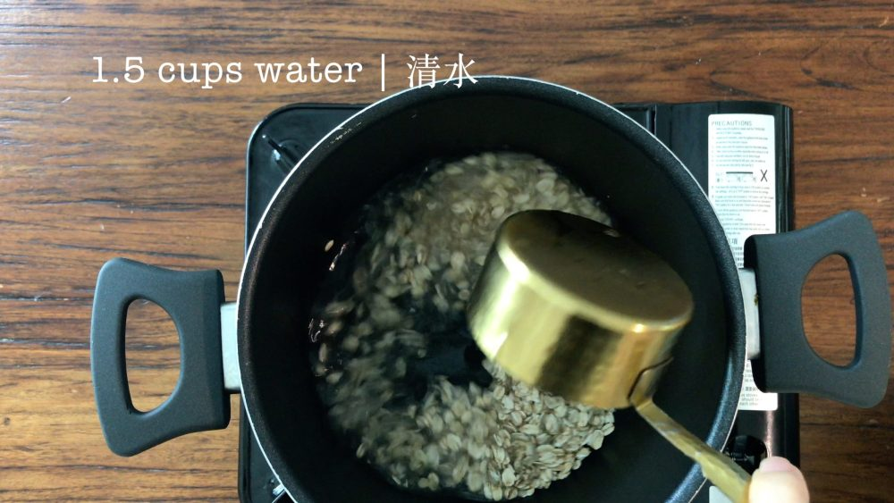 Put 1/2 cup of rolled oats in a pot, then add 1.5 cups of water.