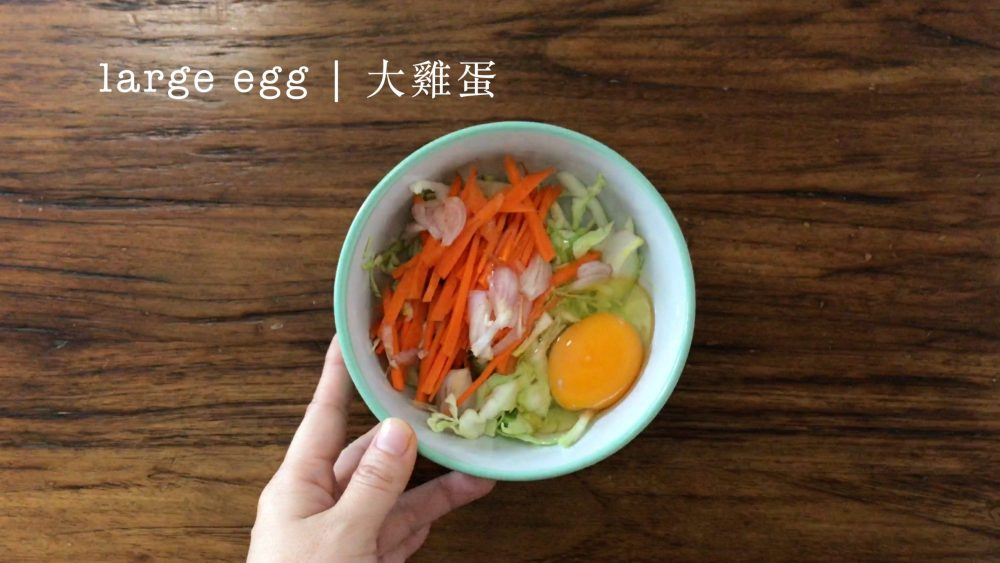 a bowl with some mixed vegetables and an egg