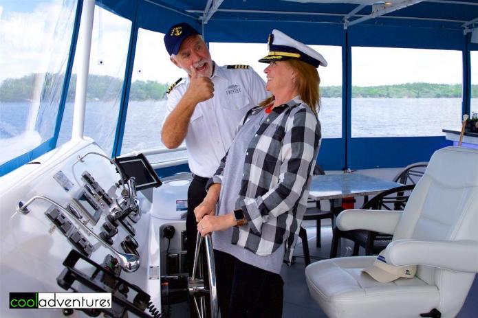 Kim Hull driving the boat, Destiny Cruises, Gull Lake, Minnesota