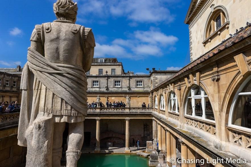 "Statue overlooking the ""Great Bath"" pool, Roman Baths, Bath"