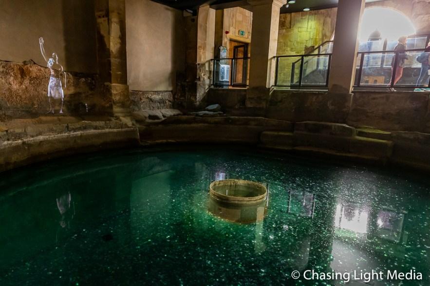Image of a bather next to a spa pool, Roman Baths, Bath, England