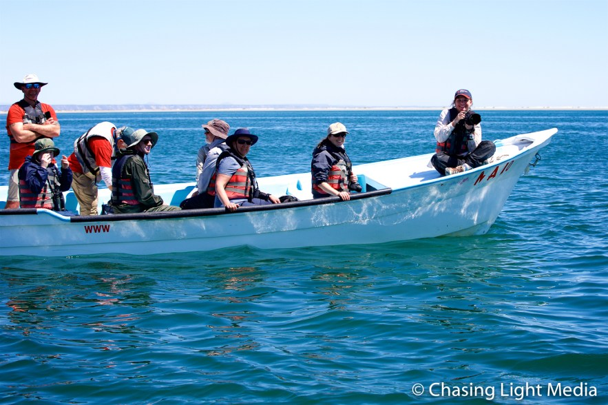 Kim Hull with her camera on the bow of the panga, San Ignacio