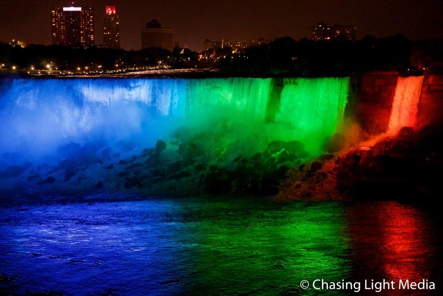Multi-colored lights glowing on American Falls, Niagara Falls, O