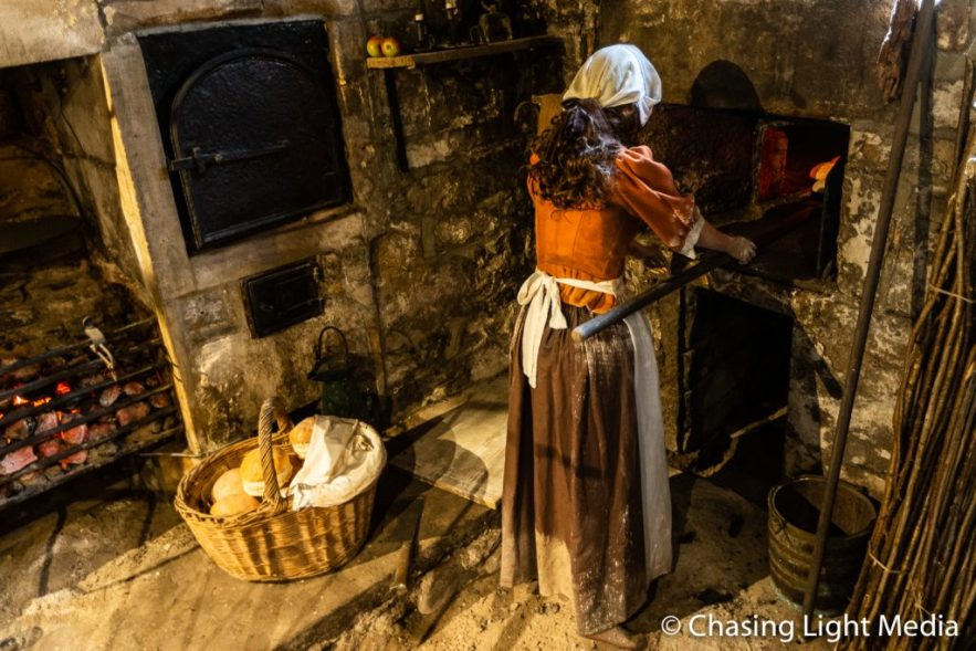 Female making bread display at Sally Lunn's Eating House 1680