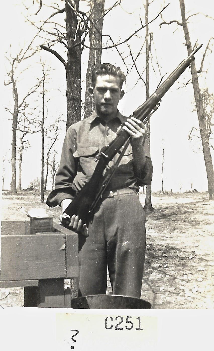 1941 Louisiana Maneuvers, Unknown person holding gun