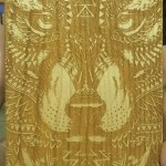 Photo of Jessica's wooden iPhone 7 case with hand-carved wolf head