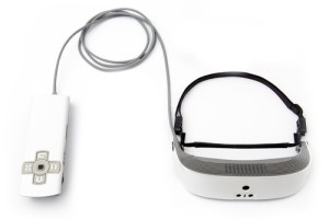 Photo of white eSight 3 device and accessories