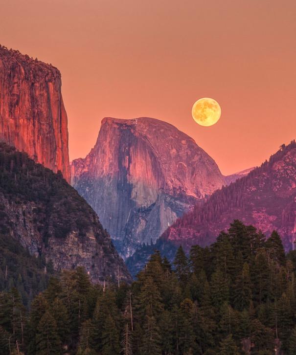 The moon hangs low over Yosemite, CA