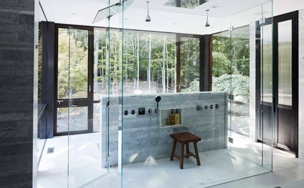 glass-enclosed-shower-cube-with-a-view-of-the-surrounding-woods-in-this-home-located-in-amagansett-n