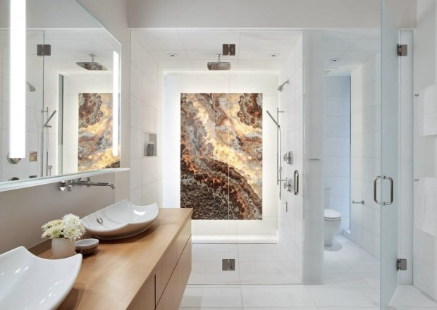 sleek-bathroom-featuring-a-stunning-onyx-panel-in-the-shower-in-this-home-in-teton-county-wyoming