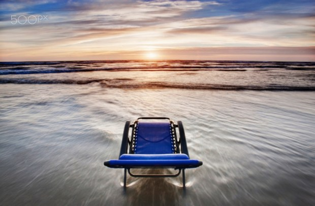 Deck chair overlooking sunset