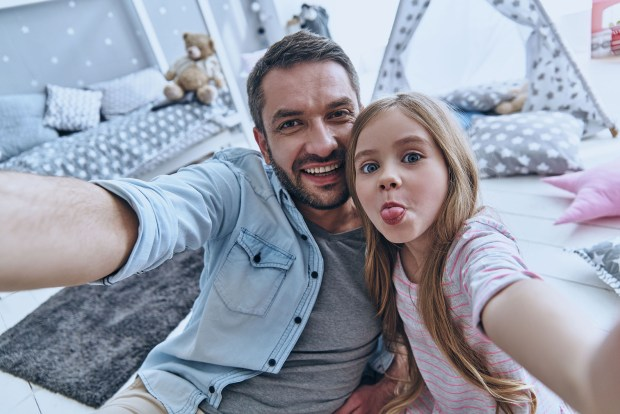 Funny selfie with dad. Self portrait of young father and his little daughter