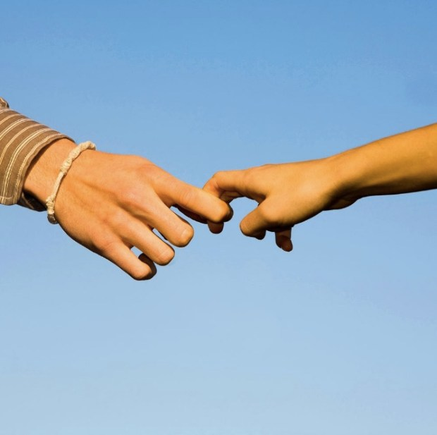 Japanese couple holding fingers