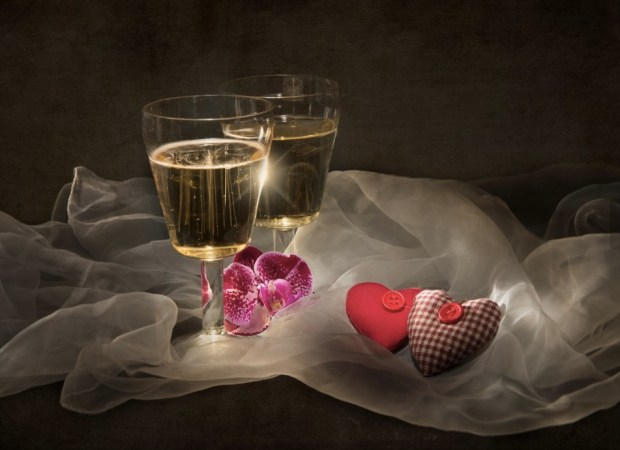Still life with two hearts and champagne
