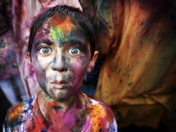 A boy with a colored powder face for the spring festival Holi