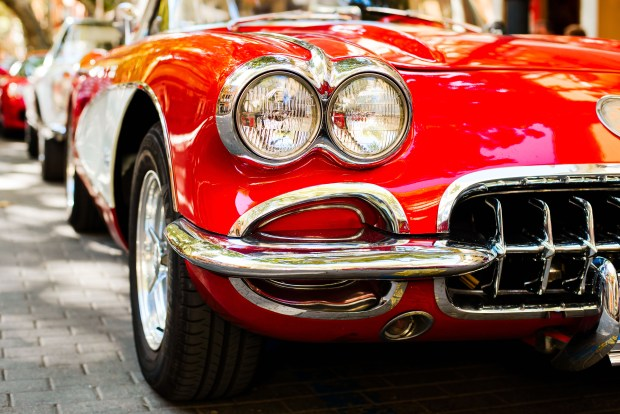 close up of headlight of red vintage car
