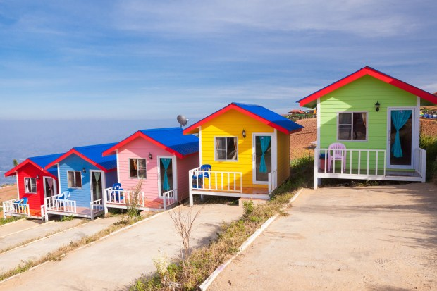 Colorful cabins on the mountain with blue sky