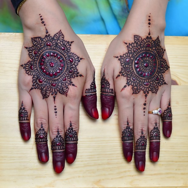 Woman Hands with black mehndi