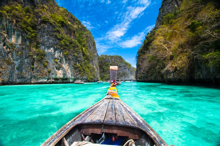 Traditional wooden boat in a picture perfect tropical bay on Koh Phi Phi Island