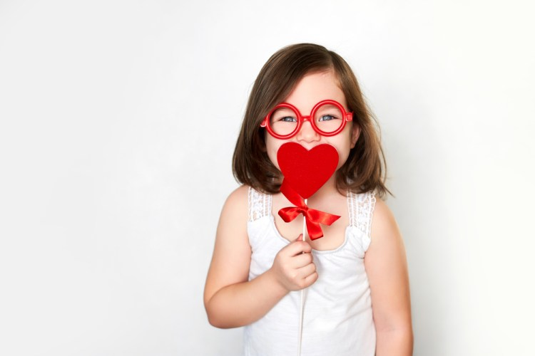 Smiling little child in toy glasses
